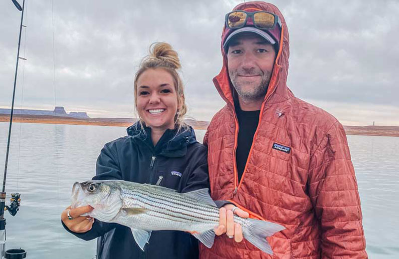couple holding a fish